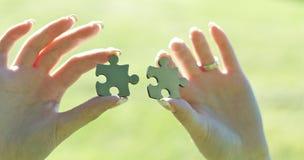 Deux parties de puzzle Photos stock