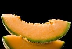 Deux parts de melon images stock