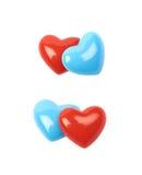 Deux perles en forme de coeur brillantes d'isolement Photos stock