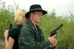 Deux personnes avec des canons, duel Photos libres de droits