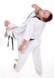 Deux personnes dans le combat de kimono sur le blanc Images libres de droits