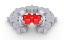 Deux personnes finissent autour du puzzle Image stock