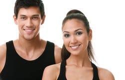 Deux personnes folâtres dans les vêtements de sport noirs Photo stock