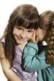 Deux petites filles disant des secrets Photos libres de droits
