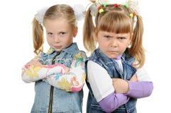 Deux petites filles fâchées Photographie stock libre de droits