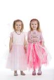Deux petites filles - meilleurs amis sur le blanc Photos libres de droits