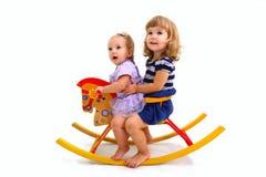 Deux petites filles sur le cheval Image stock