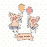 Deux petits porcs mignons se tenant avec des ballons Photos libres de droits