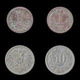 Deux pièces de monnaie européennes sur un fond noir Photographie stock