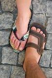 Deux pieds dans des chaussons Photographie stock