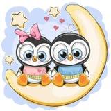 Deux pingouins se repose sur la lune Image libre de droits