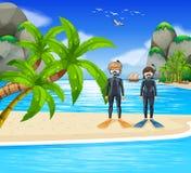 Deux plongeurs au bord de la mer Photographie stock
