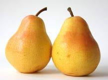 Deux poires jaunes Images stock