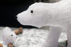 Deux polaires en verre de jouet concernent un fond foncé Photos stock