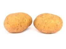 Deux pommes de terre d'isolement Photographie stock libre de droits