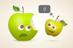 Deux pommes drôles Image stock