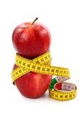 Deux pommes et mesures de bande rouges Image libre de droits