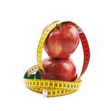 Deux pommes rouges mûres d'isolement Photo stock