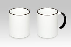 Deux positions d'une tasse blanche Photo stock