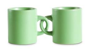 Deux pour le prix d'un met en forme de tasse. Photographie stock