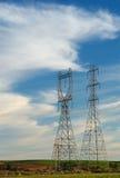 Deux pylônes au coucher du soleil Image libre de droits