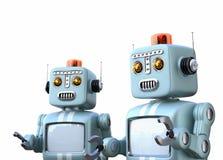 Deux rétros robots d'isolement sur le fond blanc Image libre de droits