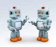 Deux rétros robots parlant entre eux Image stock