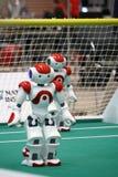 Deux robots d'Ordonnateur national du Robocup 2009 Image libre de droits