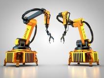 Deux robots industriels Photos libres de droits