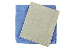 Deux serviettes fois de textile sur le blanc Images stock