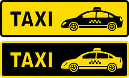 Deux signes de taxi Photo stock