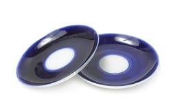 Deux soucoupes bleues Photo stock