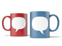 Deux tasses avec des discours de bulle Photographie stock libre de droits