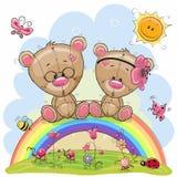 Deux Teddy Bears se reposent sur l'arc-en-ciel Photographie stock
