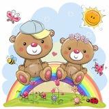 Deux Teddy Bears se reposent sur l'arc-en-ciel Photo stock