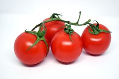 Deux tomates-cerises sur le fond blanc Photos stock