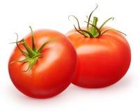 Deux tomates rouges fraîches entières avec les feuilles vertes Photos stock