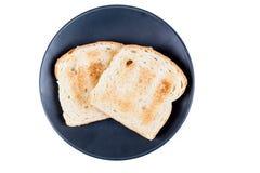 Deux tranches de pain entières de grain grillées Image stock