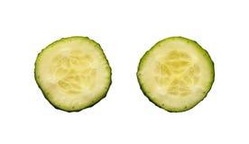 Deux tranches fraîches de concombre Photos libres de droits