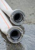 Deux tuyaux d'incendie de fins Image stock