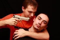 Deux types jouant avec le canon Images stock