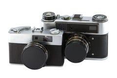 Deux vieux appareils-photo de film. Grand et petit. Photographie stock