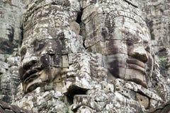 Deux visages en pierre au temple de Bayon Image stock