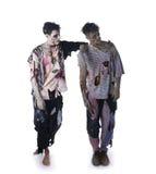 Deux zombis masculins se tenant sur le fond blanc, corps entier Photos libres de droits