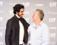 Dev Patel with writer John Collee press conference for Hotel Mumbai Toronto International Film Festival Royalty Free Stock Image