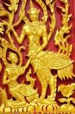 Deva hölzernes Schnitzen von Wat Se Nas Stockbild