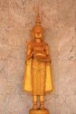 Deva pstatue. Close up golden statue of deva in the temple at Saraburi province royalty free stock image