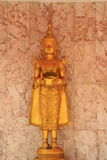 Deva statue. Close up golden statue of deva in the temple stock image