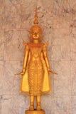 Deva statue. Close up golden statue of deva in the temple royalty free stock photos