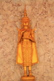 Deva statue. Close up golden statue of deva in the temple royalty free stock photography